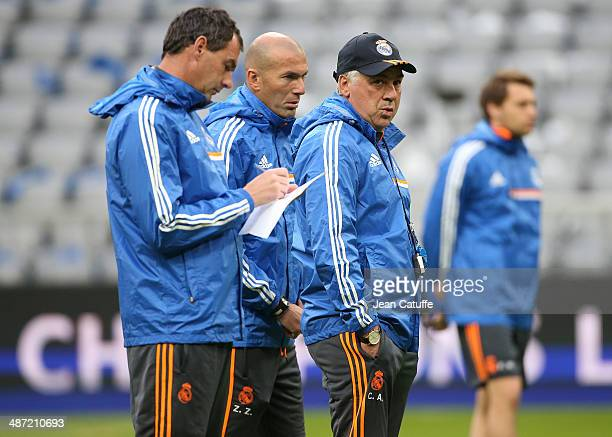 Assistantcoaches Paul Clement and Zinedine Zidane and the headcoach of Real Madrid Carlo Ancelotti direct the training session on the eve of the UEFA...