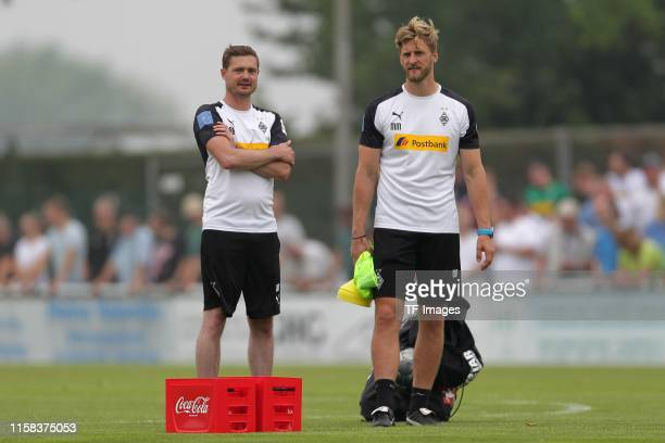 assistants coach Rene Maric of Borussia Moenchengladbach and Athletic coach Markus Mueller of Borussia Moenchengladbach look on during the preseason...