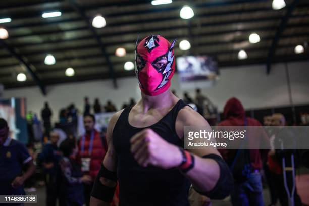 Assistants practice Mexican wrestling in Sportfest a space where different physical and sports activities are carried out in Corferias of Bogota...