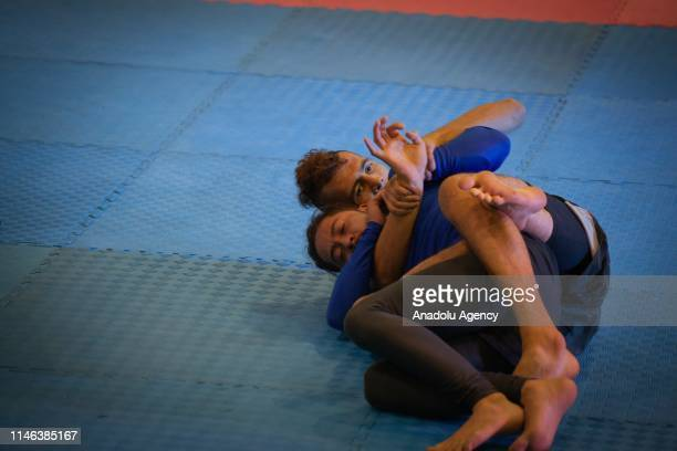 Assistants practice mixed martial arts wrestling in Sportfest, a space where different physical and sports activities are carried out in Corferias of...