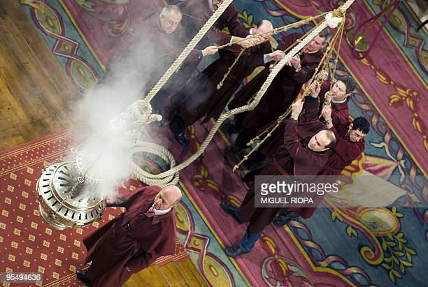 Assistants prepare the Botafumeiro the world's biggest thurible with ropes during a religious ceremony at the Cathedral of Santiago de Compostela...