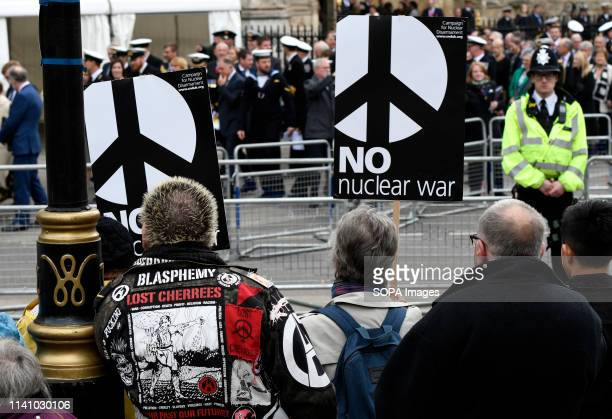 Assistants to the Royal Navy thanksgiving service seen during the protest Antinuclear activists gathered opposite Westminster Abbey in London to...