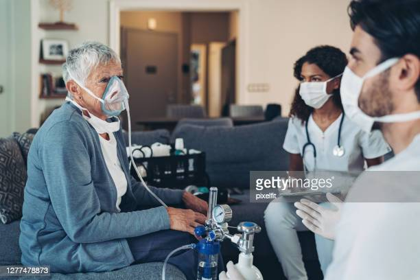 assisted breading for a senior woman - medical oxygen equipment stock pictures, royalty-free photos & images