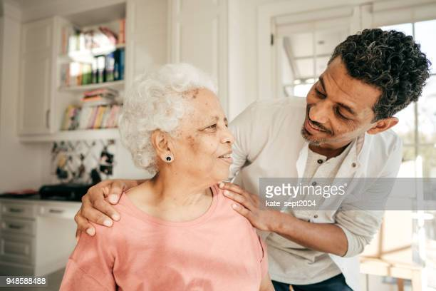 assisted care at home - healthcare workers stock pictures, royalty-free photos & images