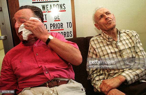 Assisted suicide advocate and retired pathologist Dr Jack Kevorkian addresses reporters as his associate psychiatrist Dr Georges Redding wipes a tear...