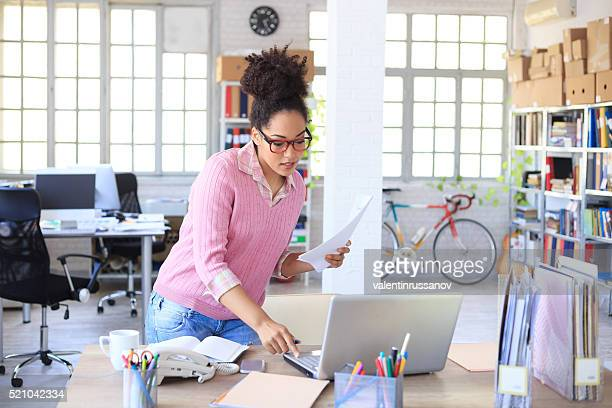 Assistent arranging the desk at workplace