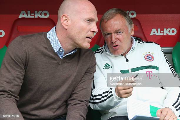Assistent coach Hermann Gerland of Muenchen talks to Matthias Sammer sporting director of Muenchen prior to the Bundesliga match between FC Augsburg...