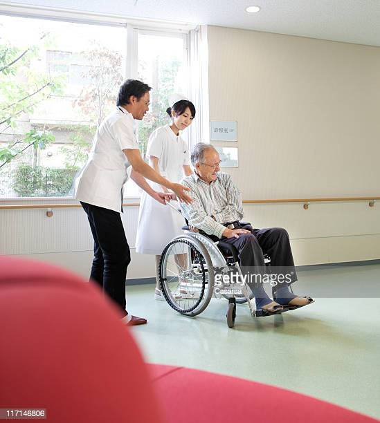 assisting the patient - multiple sclerosis stock photos and pictures