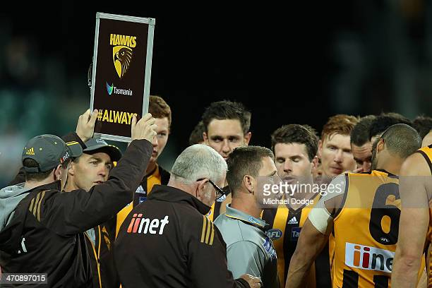 Assitant coach Brendon Bolton coaches the players while head coach Alastair Clarkson looks on during the round two AFL NAB Challenge match between...