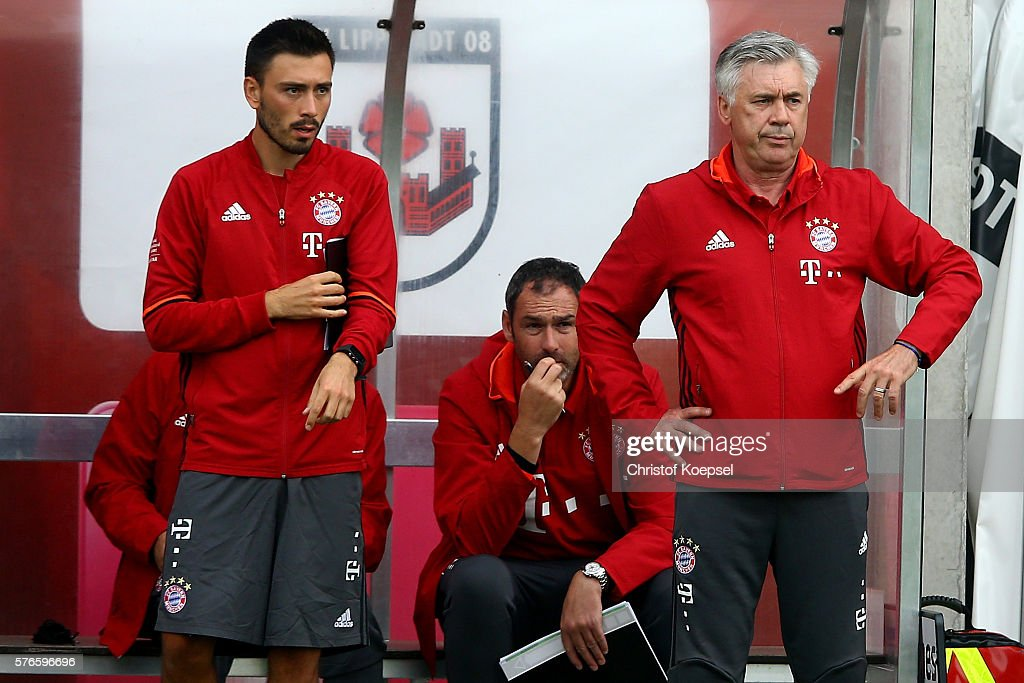 Assitant coach Davide Ancelotti and head coach Carlo Ancelotti of Bayern Muenchen stand on the bench during the friendly match between SV Lippstadt and FC Bayern at Stadion am Bruchbaum on July 16, 2016 in Lippstadt, Germany.