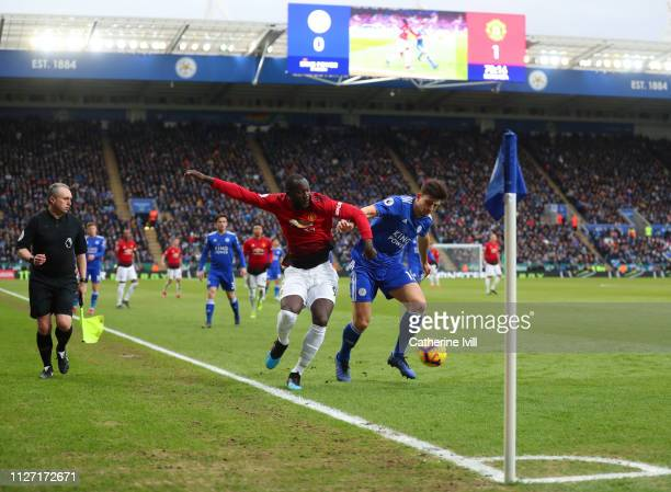 Assitant referee Darren Cann watches as Romelu Lukaku of Manchester United competes with Harry Maguire of Leicester City during the Premier League...