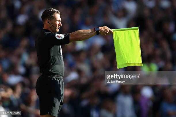 Assitant referee is seen during the Premier League match between Arsenal FC and Tottenham Hotspur at Emirates Stadium on September 01 2019 in London...