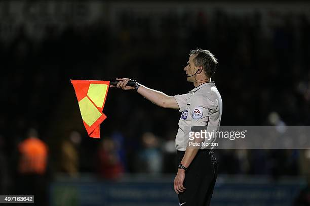 Assitant referee Mark Mellor gives an offside decision during the Sky Bet League Two match between Northampton Town and Mansfield Town at Sixfields...