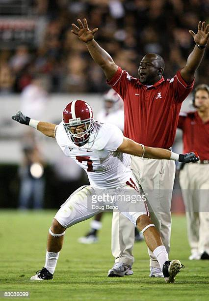 Assitant running back coach Sedrick Irvin and Will Oakley of the Alabama Crimson Tide celebrate after the Crimson Tide scored a touchdown in the...