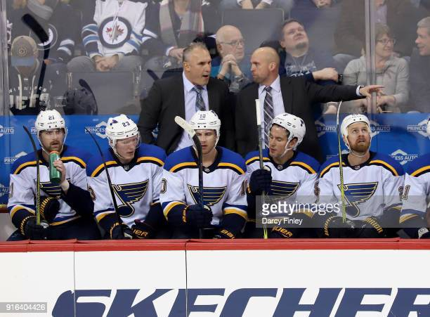Associate Coach Craig Berube and Head Coach Mike Yeo of the St Louis Blues discuss strategy on the bench during second period action against the...