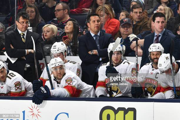 Associate Coach Jack CapuanoHead Coach Bob Boughner and Assistant Coach Paul McFarland all of the Florida Panthers watch their team during a game...