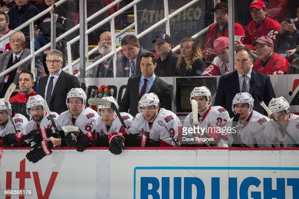 Associate coach Marc Crawford and head coach Guy Boucher and assistant coach Martin Raymond of the Ottawa Senators watches the action from the bench...