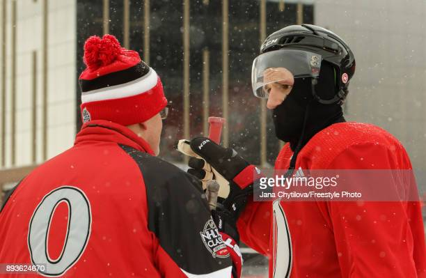 Associate coach Marc Crawford chats with Dion Phaneuf of the Ottawa Senators during practice at Lansdowne Park on December 15 2017 in Ottawa Canada