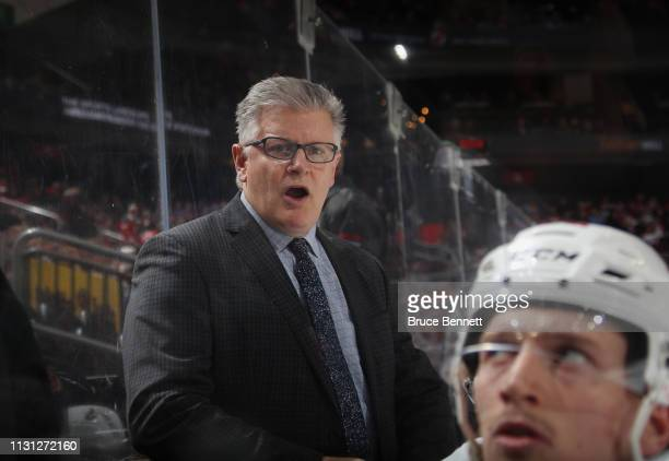 Associate coach Marc Crawford of the Ottawa Senators handles bench duties during the second period against the New Jersey Devils at the Prudential...