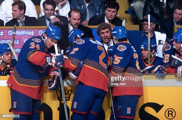Associate coach Roger Neilson of the St Louis Blues calls out a play to the Blues as head coach Mike Keenan listen on prior to a game against the...