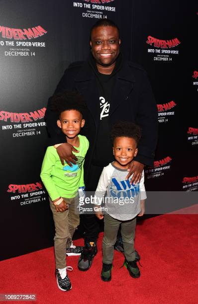 Associate Director Rhythm and Soul Jason Reddick poses with his sons during the 'Spiderman Into The SpiderVerse' Atlanta screening at Regal Atlantic...
