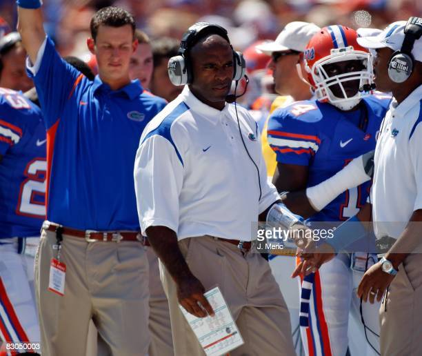 Associate Head Coach Charlie Strong of the Florida Gators directs some players against the Mississippi Rebels during the game on September 27, 2008...