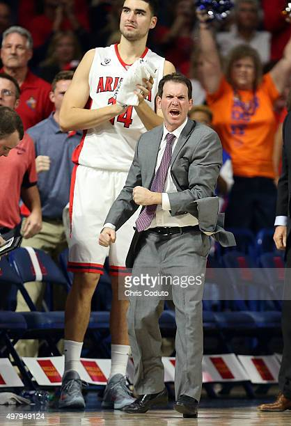 Associate head coach Joe Pasternack celebrates a basket during the second half of the college basketball game against the Boise State Broncos at...