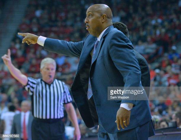Associate head coach Lorenzo Romar of the Arizona Wildcats gestures during his team's game against the UNLV Rebels at the Thomas Mack Center on...