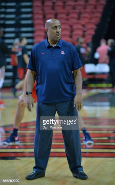 Associate head coach Lorenzo Romar of the Arizona Wildcats stands on the court during warmups before his team's game against the UNLV Rebels at the...