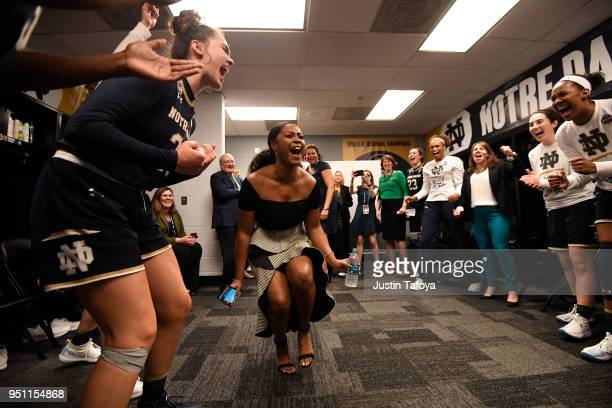 Associate head coach Niele Ivey of the Notre Dame Fighting Irish celebrates in the locker room after the semifinal game of the 2018 NCAA Photos via...
