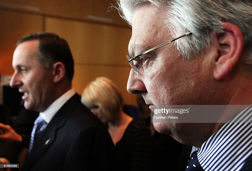 Associate Health Minister Peter Dunne listens as New Zealand Prime Mininster John Key speaks to the media about the government's new anti-pseudoephedrine package on October 8, 2009 in Auckland, New Zealand. The government has announced a ban on over-the-counter sale of the drug pseudoephedrine, or P, which is commonly used in cold and flu medications. Addiction to the drug has become an increasing problem in New Zealand and the government will invest a further NZ$22 million for P treatment over the next three years and increase investment in special detox facilities.