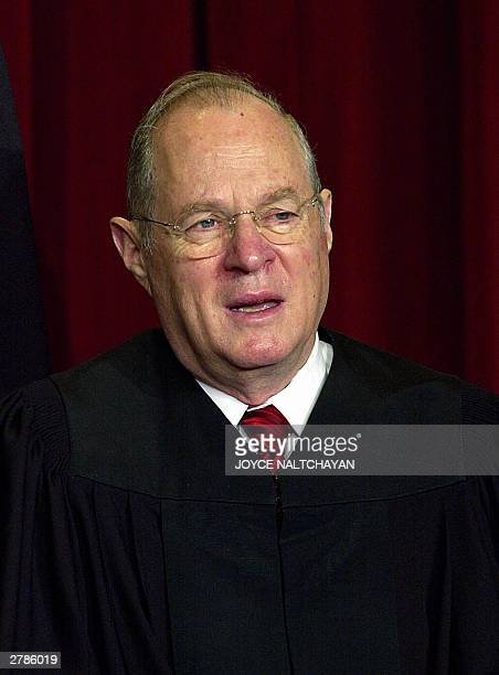 Associate Justice Anthony Kennedy looks on as the Supreme Court of the United States poses for an official photo 05 December at the Supreme Court in...