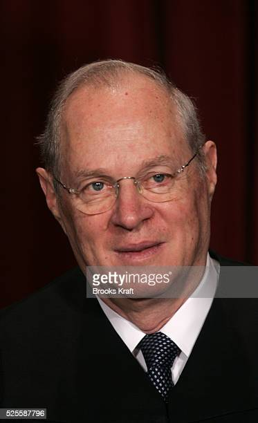 US Associate Justice Anthony Kennedy poses for an official picture with other justices at the US Supreme Court in Washington DC October 31 2005