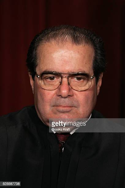 US Associate Justice Antonin Scalia poses for an official picture with other justices at the US Supreme Court in Washington DC October 31 2005