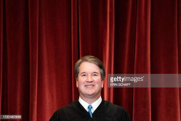 Associate Justice Brett Kavanaugh stands during a group photo of the Justices at the Supreme Court in Washington, DC on April 23, 2021.