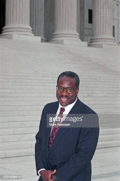Associate Justice Clarence Thomas poses on the plaza of the United States Supreme Court after the traditional escort out of the front doors of the...