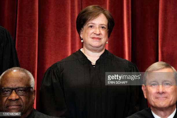 Associate Justice Elena Kagan , with Associate Justice Clarence Thomas and Chief Justice John Roberts in front of her, stands during a group photo of...