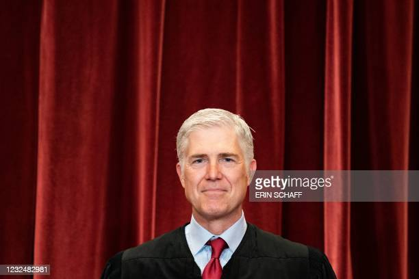 Associate Justice Neil Gorsuch stands during a group photo of the Justices at the Supreme Court in Washington, DC on April 23, 2021.