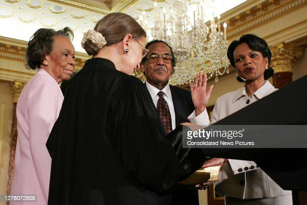 Associate Justice of the US Supreme Court Ruth Bader Ginsburg administers the oath of office to incoming US Secretary of State Condoleezza Rice...