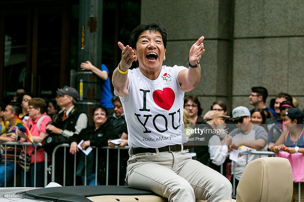 Associate Justice of the Washington Supreme Court Mary Yu makes an apperance in the 40th annual Seattle Pride Parade on June 29, 2014 in Seattle, Washington.