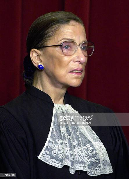 Associate Justice Ruth Bader Ginsburg looks on as the Supreme Court of the United States poses for an official photo, 05 December at the Supreme...