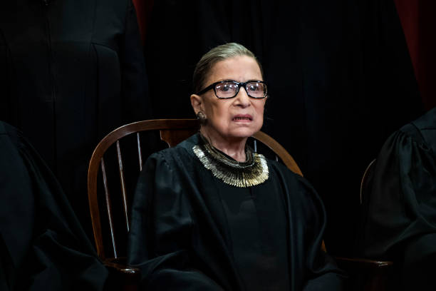 Associate Justice Ruth Bader Ginsburg poses with other Justices of the United States Supreme Court during their official group photo at the Supreme...