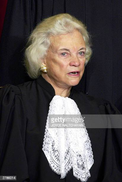 Associate Justice Sandra Day O'Connor looks on as the Supreme Court of the United States poses for an official photo, 05 December 2003 at the Supreme...
