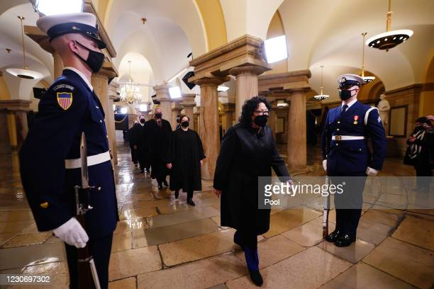 Associate Justice Sonya Sotomayor and the US Supreme Court Justices as they arrive in the Crypt of the US Capitol for President-elect Joe Biden's...