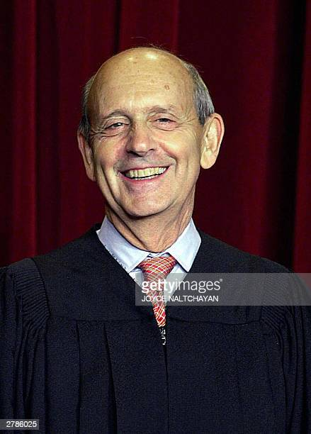 Associate Justice Stephen Breyer looks on as the Supreme Court of the United States pose for an official photo, 05 December 2003 at the Supreme Court...