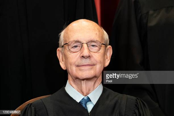 Associate Justice Stephen Breyer sits during a group photo of the Justices at the Supreme Court in Washington, DC on April 23, 2021.