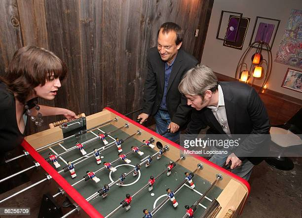 Associate producer Amanda Marshall director Joshua Goldin and actor Matthew Broderick play foosball during the after party for Wonderful World during...