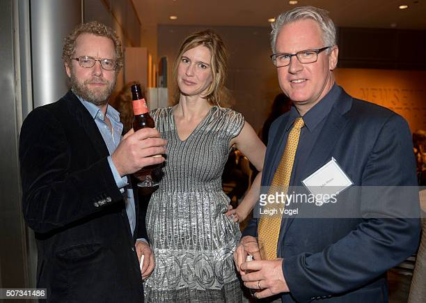 Associated Press photographer Brennan Linsley Director of Partnership and the WILD Foundation Amy Lewis and Getty Images photographer John Moore pose...