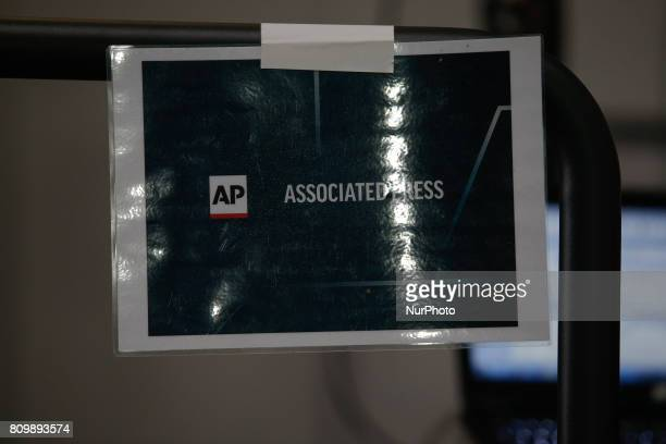 A Associated Press television sign is seen at the press center in the Hamburg Messe where the 2017 G20 meeting will be held on Friday and Saturday