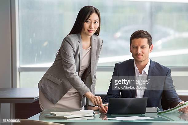 Associates working as team in office